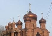Медные купола с ажурными крестами